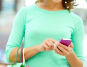 woman using her mobile device while shopping