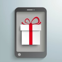 Smartphone with white gift on the grey background. Eps 10 vector file.
